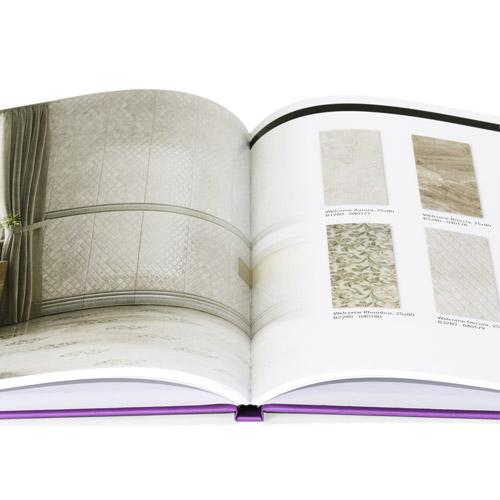 detalle de apertura de un catalogo encolado con portada de cartone